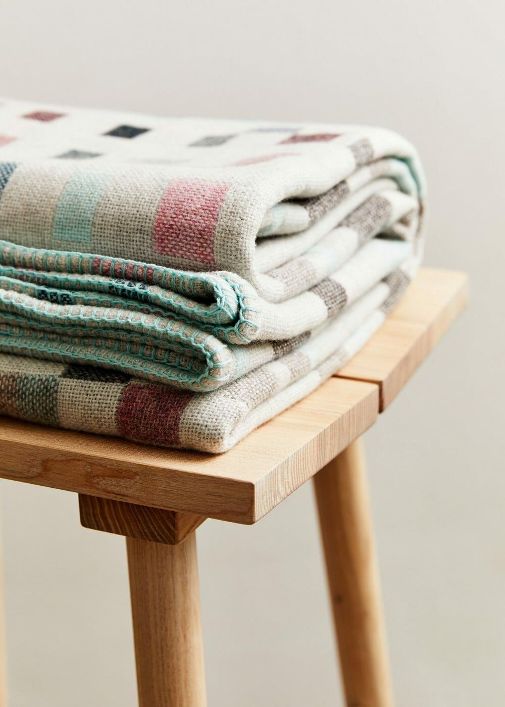 macaron-blanket-textiles-design-candleholder-books-shelving-furniture-design-homeware