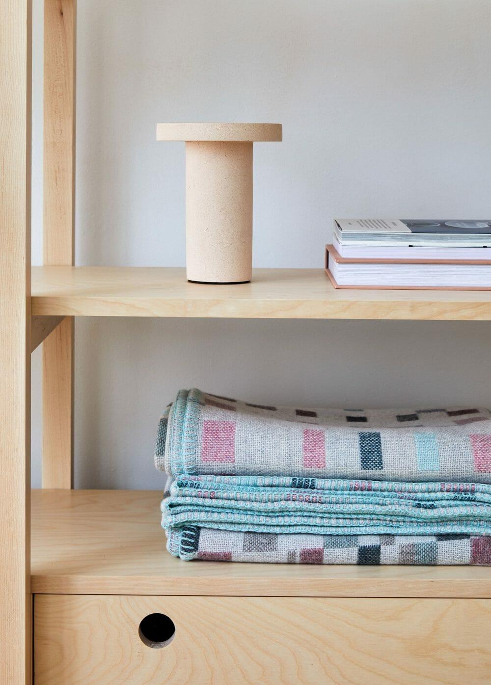 macaron-blanket-textiles-design-candleholder-books-shelving-furniture-design