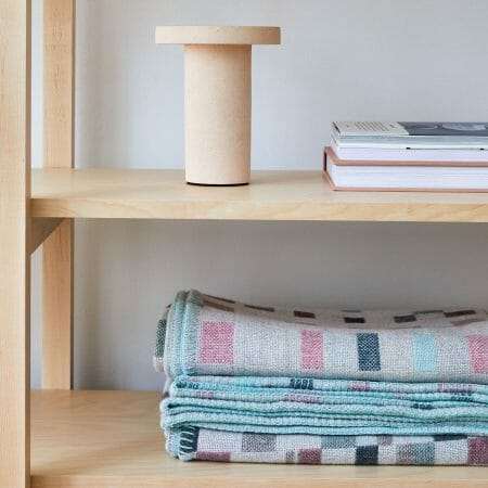 macaron-blanket-textiles-design-candleholder-books-shelving-furniture-design
