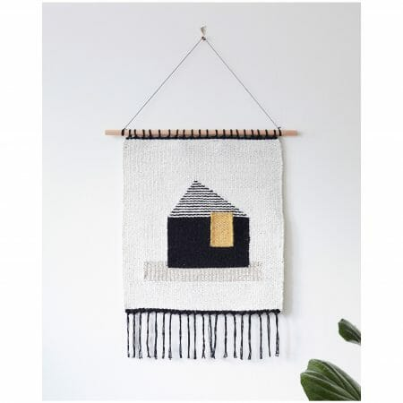 talo-wall-hanging -art-textiles-tapestry-black-mustard-house-white-backgroundwhite