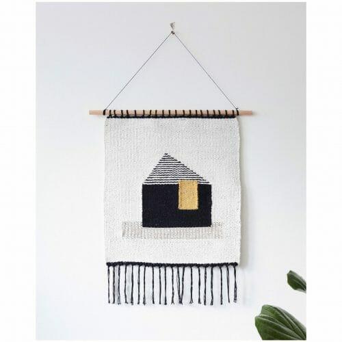 talo-wall-hanging -art-textiles-tapestry-black-mustard-house-white-backgroundwhite