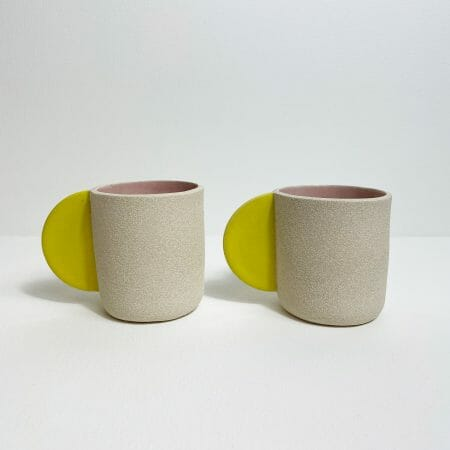 Bright-yellow-with-pink-interior-cups-ceramics-handmade-pottery