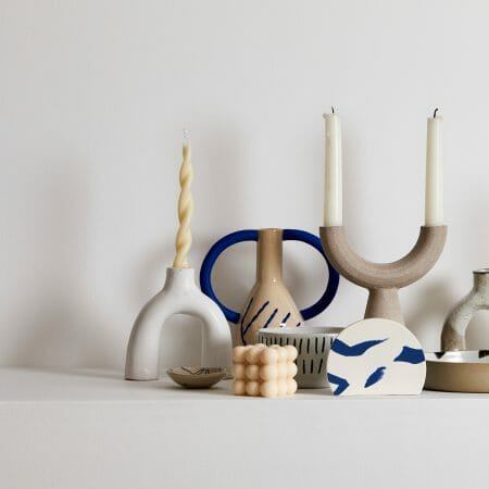 "White-leggy-ceramic-handmade-cream-shaped-like-upsidedown-letter-""U"""
