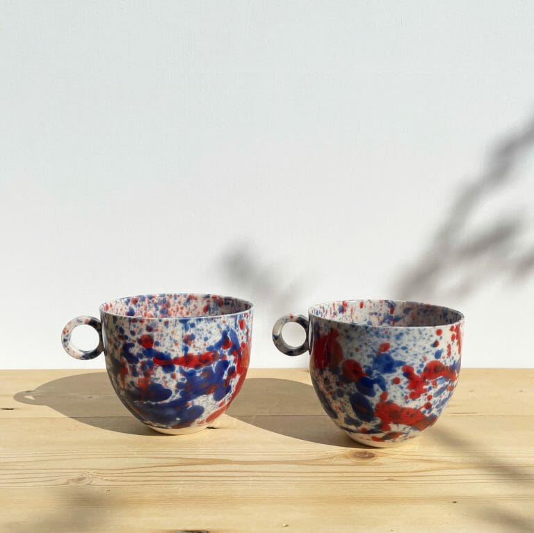 blue-and-red-splatter-mug-drips-splashes-colour-pottery-cup-circle-handle