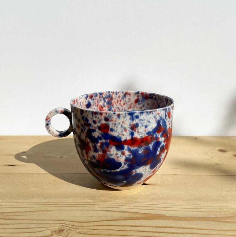 blue-and-red-splatter-mug-porcelain-drips-splashes-colour-pottery-cup-circle-handle